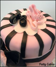 Dance cake with fondant ballet and tap shoes on top