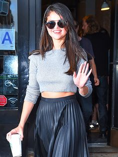 From her crop top, to her leather midi skirt, to her industrial-inspired round sunnies, Selena Gomez's style is totally badass chic!