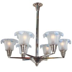 French Art Deco Chandelier | From a unique collection of antique and modern chandeliers and pendants  at https://www.1stdibs.com/furniture/lighting/chandeliers-pendant-lights/