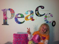 A DIY craft my 8 year old did using white wooden letters, some paint, glitter foam stickers and some craft wire. We are thinking of hanging them with ribbon from a curtain rod on the wall.