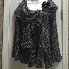 Ruffled Sweater Ruffled sweater has an asymmetrical zip up front with bell sleeves and a layered unique shaped neckline Black, white & gray Made in France In excellent condition I hate to part with it but It's too small for me now  Zone Bleue Sweaters Crew & Scoop Necks