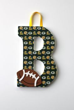 Green Bay Packers Football Decorated Wood Letter Door Hanger with wooden football embellishment on Etsy, $23.00