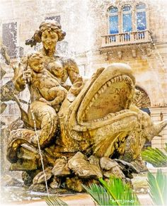Fishy frolics in a magnificent fountain in Ortigia, Siracusa, Sicily.