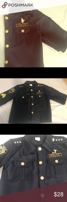 Child Police 👮🏻 Costume Worn once for an hour. Navy blue in color. Has gold buttons and has two pockets in front of chest. It has Velcro for easy adjustments. Back of top says POLICE in large white letters. Kids love to dress up all year so it's never to early!   Top measures 16.5 in width from pit to pit Bottom pants measure 12 inches stretch waist band  23 inches in length. Costumes Halloween