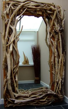 Floor Standing Driftwood Mirror; project with collected driftwood for bedroom