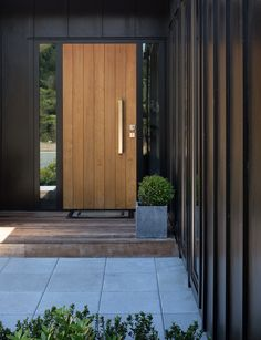 This black-clad Taupo home was designed with two master bedrooms. Click the link in our bio to find out why. Photography by:… Modern Entrance, Entrance Ways, Entrance Doors, Front Doors, Cottage Exterior, Exterior House Colors, Exterior Design, Waterfall Taps, Building A New Home