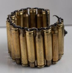 Leather bound bullet casing bracelet Fastens with a loop and the end of a bullet casing. ***Important*** Please let me know what length you need.