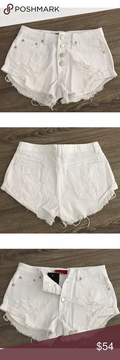 """🆕 White Denim Shorts Brand New, Tags Attached  Mid-Rise, 5 functional pockets, 2 Front pockets that peak out from underneath. Distressed, curved side fold to elongate your legs, and 4 button up closure.  * Comparable to brand One Teaspoon  Measures: 13.5"""" Waist 16.5"""" Hips  Model ( Elaine: 5'3"""", 103 lbs ) Color: White Size: Small Shorts Jean Shorts"""