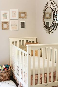 Baby girl nursery | peach & gray. I love the mismatched frames and that gorgeous mirror