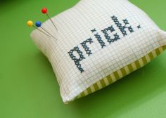 Prick.  pin cushion. so appropriate on so many levels