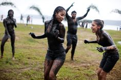 Covered in mud, people participate in a Carnival mud party in Paraty, Brazil.