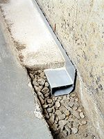 Got a wet basement? Learn how French drains work and why the WaterGuard interior drainage system from Basement Systems is a better waterproofing alternative to an exterior French drain.