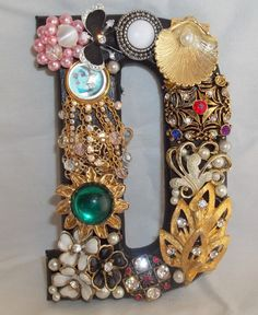 A true memory board! Use whichever letter carries the memory and embelish with that persons costume jewelry.