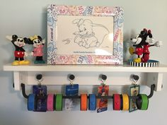 Disney Magic Bands displayed on a shelf from IKEA.