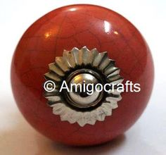 http://www.amigocrafts.com/ProductDetail.aspx?m=0&c=0&sc=22&q=79&tag=Red%20Crackle%20Round%20Ceramic%20Knob