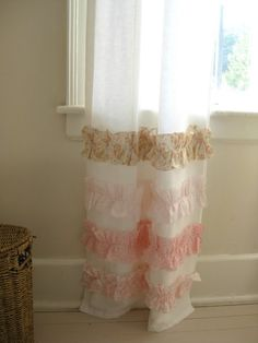 curtains with strips of fabric ruffled near the bottom! @Ellie Kirkland - this would be so lovely in your girl's bedroom... I love the sheer white contrast with the pretty prints :-)