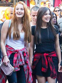 Barely Lethal costars Sophie Turner and Hailee Steinfeld wear tied plaid shirts outside a theater at L.A.'s The Grove before a showing of their new movie on Thursday.