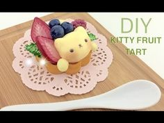 Learn how to create this adorable Fruit Tart with a custard kitten in the center using polymer clay. This step by step tutorial will show you how you can cre...
