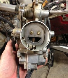 That is the happiest carburetor I have ever seen!