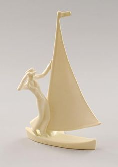 White glazed sculpture of a sailing woman design Etha Lempke 1928-'29 executed by Zuid-Holland Gouda / the Netherlands