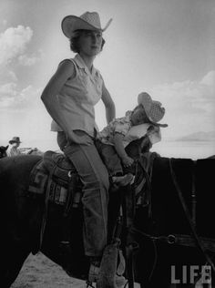Someone got a little sleepy on her ride around the ranch. #JeanAnneEvans #YoungestCowgirl #LIFEarchives | LIFE Magazine | quitecontinental.com