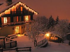 Christmas in a cosy chalet/log cabin (with burning fire) in a place where there will be snow on the actual day! Lovely.