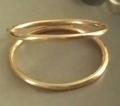 Check out this item in my Etsy shop https://www.etsy.com/listing/242886241/gold-double-ring-band-yellow-gold-filled