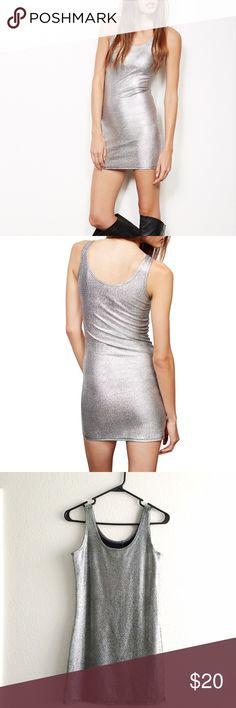"""Flash SALE // Metallic Bodycon Dress New with tag Silver Metallic Dress Shiny metallic fabric with a crackled finish. Double scoop neckline.  Stretchy fit bodycon tank dress. 96% polyester, 4% spandex.  30"""" from shoulder to hem. 15"""" laid flat from armpit to armpit.  No trades. Ships daily Mon to Fri. """"Add to Bundle"""" 2+ items or ask me to bundle to save! Wet Seal Dresses Mini"""