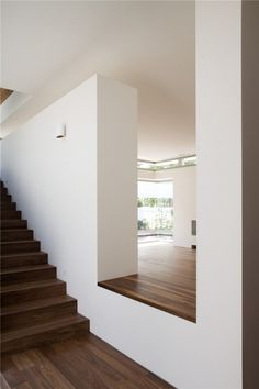 Dark wood and white plaster walls. Interior view of the K House by Alroy Hazak architects.