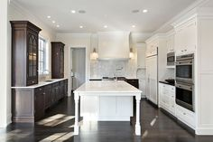 I love the two counter to ceiling glass-front uppers. This is a dream kitchen.