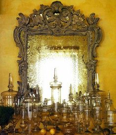 ochre walls, carved mirror, apothecary jars...