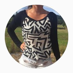 Aztec Long Sleeve Shirt Aztec print black and white long sleeve shirt. Sheer material in the middle. Stretching soft material for sleeves. Only wore once and is in perfect condition. No stains, tears, fading, ect. Made in the USA Charlotte Russe Tops