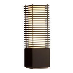 Simple, clean contemporary Asian lamp design. The horizontal bars act as a screen for the light inside.