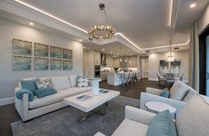 Transitional white living room with aqua blue accent chairs. Blue Living Room Decor, Living Room Colors, Living Room Modern, Home Living Room, Living Room Designs, Blue Accent Chairs, Blue Chairs, Comfortable Living Rooms, Minimalist Living
