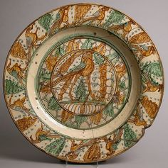 Plate Date: 15th century Culture: Italian Medium: Earthenware, tin-glaze Dimensions: Overall: 2 3/4 x 20 1/4 in. (7 x 51.4 cm)