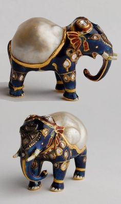 Gold and enamel figurine of an elephant with large natural baroque pearl forming its back and diamonds on its head. Mughal, India.
