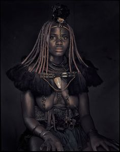 The Himba are an ancient tribe of tall, slender and statuesque herders. Since the 16th century they have lived in scattered settlements, leading a life that has remained unchanged, surviving war and droughts. The tribal structure helps them live in one of the most extreme environments on earth. (Jimmy Nelson)