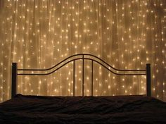 You can hang strings of lights up on the wall behind you bed and then cover that same wall with a see-through curtain. Wallah!