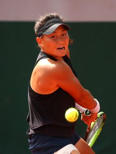Grace Min of The United States plays a backhand during the ladies singles first round match against Camila Giorgi of Italy during day two of the 2018 French Open at Roland Garros on May 2018 in Paris, France. Camila Giorgi, French Open, First Round, Opening Day, Paris France, Plays, Two By Two, United States, Italy