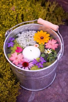 All funny and awesome ways to use (any) water for displaying flowers. From pools to buckets to tiny little glasses.