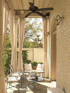 Add Curtains  To provide shade from the sun on hot days, install curtains on your porch. The cream-colored ones that designer Ty Larkins chose for his Louisiana home add an elegant touch.