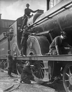 Women took on many new roles in railway service previously restricted to men. Here five women are cleaning a locomotive. During the war locomotives travelled far from their usual haunts, like this Great Central Railway locomotive at Birmingham in September 1918.