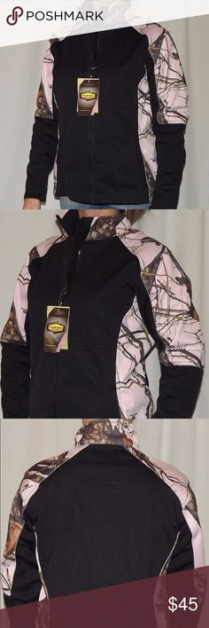 "Mossy Oak Camo Windproof Womens Jacket Price is firm. No offers please.   S-Bust: 20-21"" Length: 25.5""  Shoulder to Shoulder: 16.5""  Shoulder Seam to Cuff: 24""  M-Bust: 21-22"" Length: 26""  Shoulder to Shoulder: 17""  Shoulder Seam to Cuff: 24""  L-Bust: 23-24"" Length: 26""  Shoulder to Shoulder: 17.5""  Shoulder Seam to Cuff: 24.5""  XL-Bust: 24-25"" Length: 27""  Shoulder to Shoulder: 18""  Shoulder Seam to Cuff: 25.5""  Adjustable Velcro Wrist Cuff Fleece Lined Model shown is wearing a size small…"