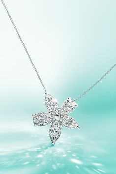 The brilliant Tiffany Victoria™ mixed cluster pendant in platinum will light up your loved one's Christmas