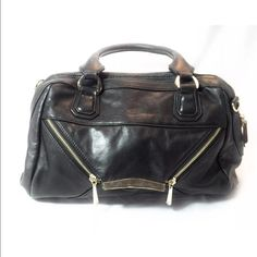 """Neiman Marcus Black Leather Envelope Satchel This is a Preowned Neiman Marcus designer Rian Signe black leather satchel bag.  The measurements are approx 14.5""""x5""""x10"""".  The gold metal does have some scratching on it from use and the leather shows some light wear.  It is a good quality bag so it has lots of life left. Neiman Marcus Bags Satchels"""