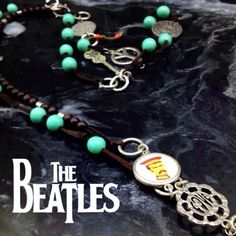 Lucky Brand • The Beatles • Sgt. Peppers Necklace SUPER RARE. This is an early Lucky Brand Collection. Mint acrylic and wooden beads adorned with charms representing Sargent Peppers Lonely Hearts Club Band! Great gift item for the aspiring rock musician or for a Beatles Collection. XINT condition. Lucky Brand Quality. Charms Described as follows: Peace Sign • Sargent Photo • Guitar (Flower Power) • Sargent Peppers Logo • Photo of Beatles in SG Peppers attire - Well protected with some type…