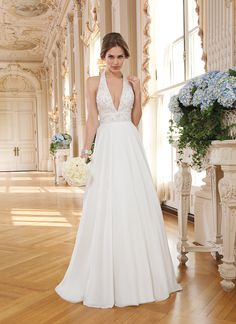 Lillian West lillian west style 6352 Chiffon A-line dress highlighted with a halter neckline.