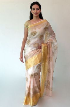 Handwoven shaded peach silk kota sari with peacock print and thick woven zari border