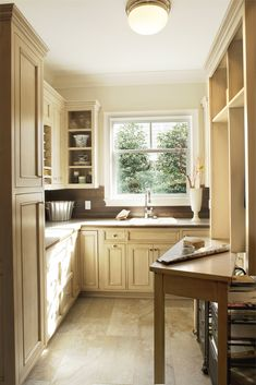 In this laundry and craft room from Amanda Webster Design, Inc., gorgeous natural woods contribute to a soft, calming ambience. Home Upgrades, Coastal Cottage, House Design, Room, Room Design, Home, Decor Design, White Cabinetry, Laundry Room