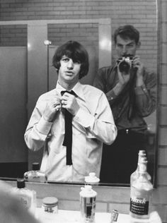 Ringo Starr (L) of the band The Beatles puts on finishing touches before stepping onto Shea Stadium in this 1965 photo. (Robert Whitaker/LIFE: With The Beatles)